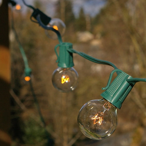 Globe String Lights, 1.5 Inch E17 Bulbs, 50 ft. Green Wire C9 Strand Clear