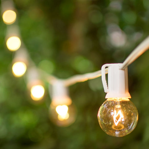 Globe String Lights, 1.5 in. E17 Bulbs, 50 ft. White Wire C9 Strand, Clear