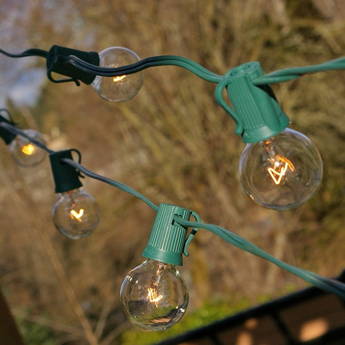 Globe String Lights, 1.5 in. E17 Bulbs, 100 ft. Green Wire C9 Strand, CLEAR