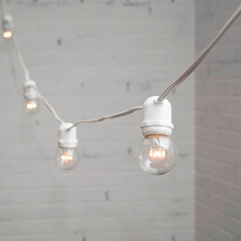 Globe String Lights, 2 Inch E12 Bulbs, 50 Foot White Wire C7 Strand, Clear