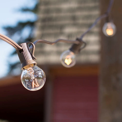 Globe String Lights, 1.25 in. Bulbs, 25 Ft Brown Wire, E12, C7, Clear