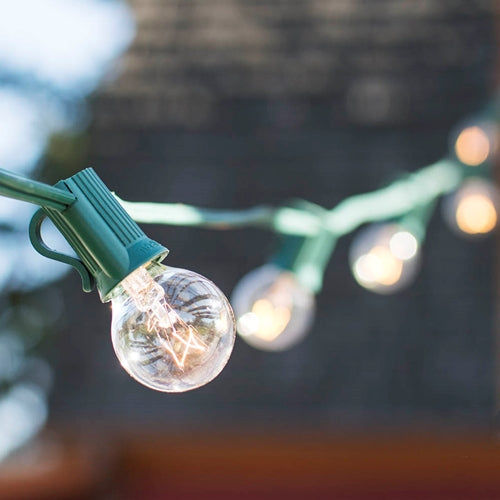 Globe String Lights, 1.25 in. Bulbs, 25 Ft Green Wire, E12, C7, Clear