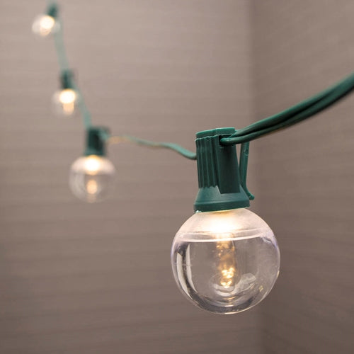 Globe String Lights, 1.5 in. LEDs, 50 ft. Green Wire, C7, Warm White