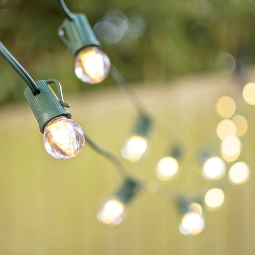LED Globe String Lights, G30 Bulb, 100 ft Green C9 Strand, Warm White