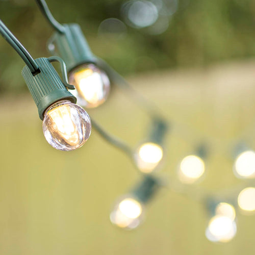 LED Globe String Lights, G30 Bulb, 50 Ft Green C9 Strand, Warm White