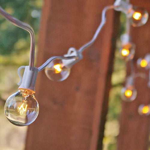 Globe String Lights, 1.5 Inch E12 Bulbs, 75 Foot White Wire C7 Strand, Clear