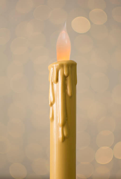 Our antique ivory flameless taper candle is molded to lend the appearance of slowly dripping wax.