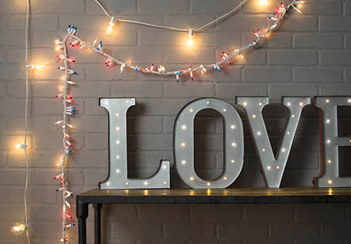 Share your patriotic love mixing popular marquee letters with globe lights and our red, white and blue cluster lights! All items sold separately.