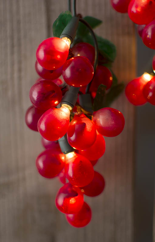 The warm glow of incandescent bulbs illuminates the interior of select grapes, for a soft and romantic light.