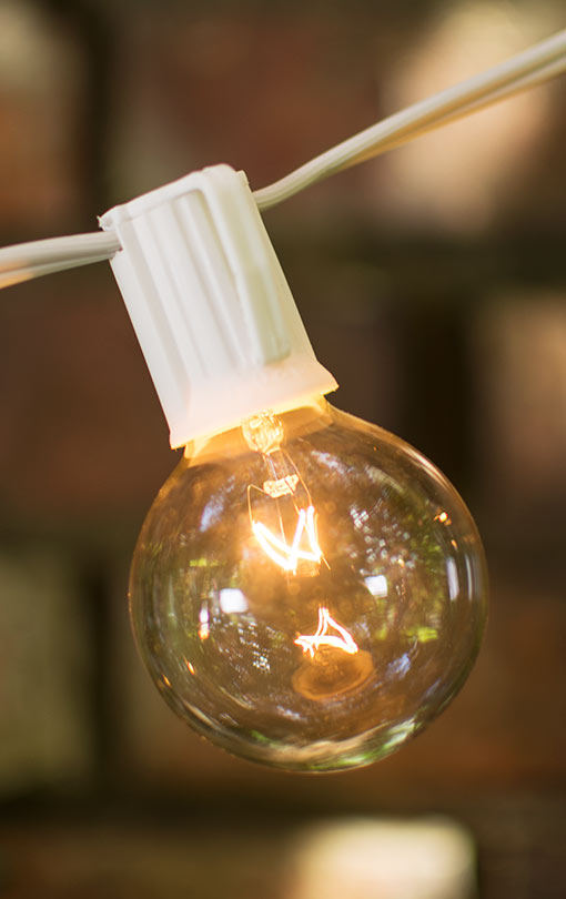 50 foot long white wire globe string lights, intermediate E17 sockets with 2 inch clear glass bulbs.