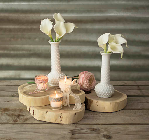 Create a shabby styled display by pairing our natural wood tree slab with our hobnail vases, votive candles and decorative floral.