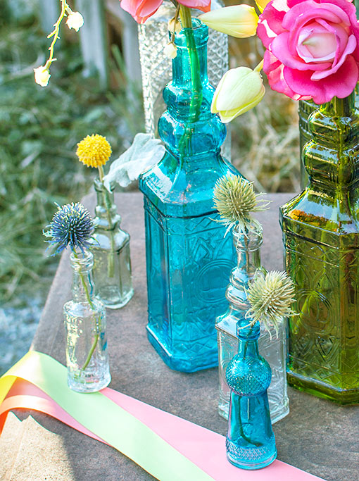 These bottles are the shortest and most delicate of our three sizes in clear glass! Using a mix of color and scale creates the most charming tablescape.