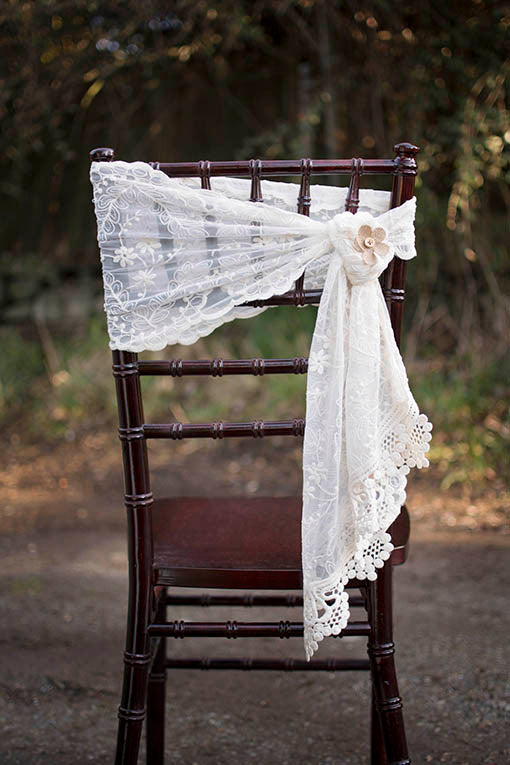 Our beautiful ivory lace runner can also be used as a flowing chair sash.