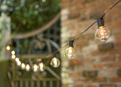 Globe String Lights, 2 in. Bulbs, C9, 100 ft. Black Wire, Outdoor, Clear