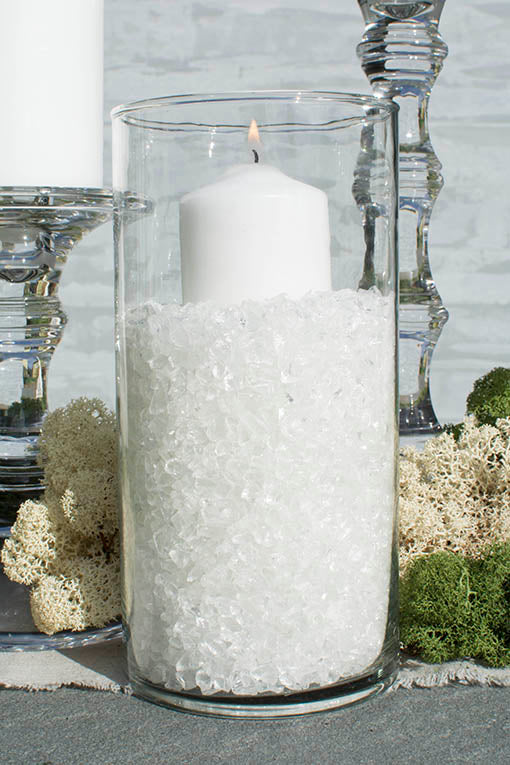 Clear glass filler shown here with a variety of clear glass table decor, event candles and natural mosses, all sold separately.