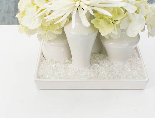 Bring a contemporary edge to your floral arrangements with the modern look of glass fragments.