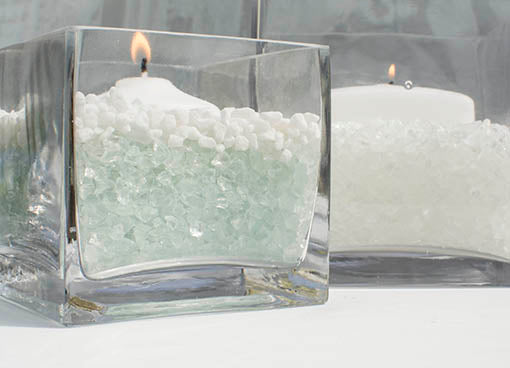Mix it up to create a layered, beach-friendly look! Use clear glass vases with multiple types of vase filler to craft simple yet unique centerpieces.