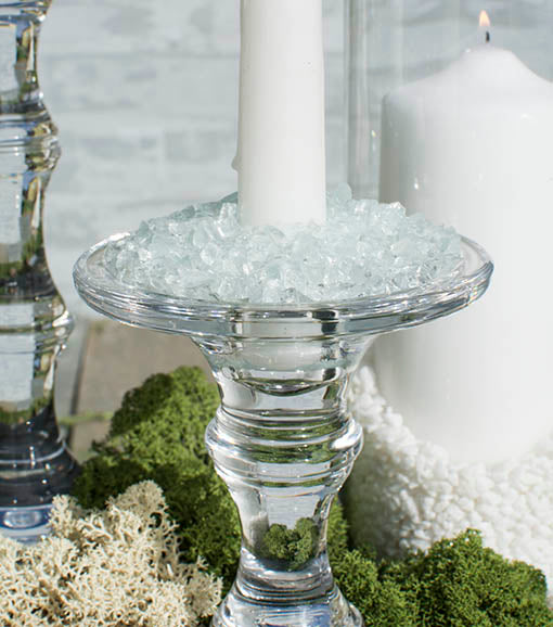 Vase filler can add texture to your table in unexpected ways: our clear glass decor pairs extraordinarily well with crushed glass filler and natural moss.