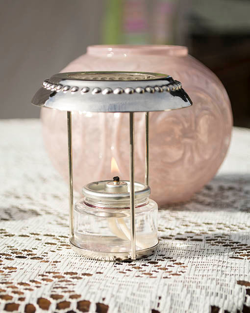 The silver wire encasing holds most tea lights, measuring 1.5 inches in diameter.