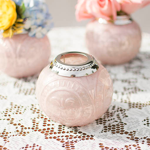 The fanciful round form of our pink mercury glass holder adds whimsical class to your table.
