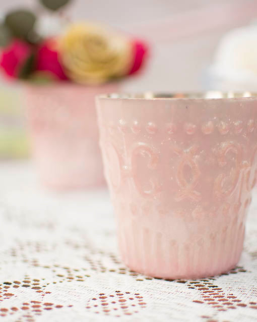 These delightful reproduction votive holders feature a delicate relief surface pattern, adding to their vintage charm.