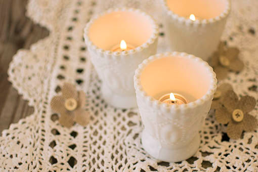 White Heirloom Tea Light Holders with candles
