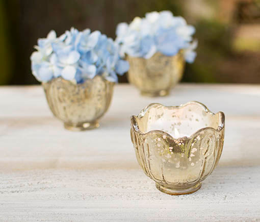 This stylish cast glass votive candle holder also performs beautifully as a small vessel for floral arrangements.