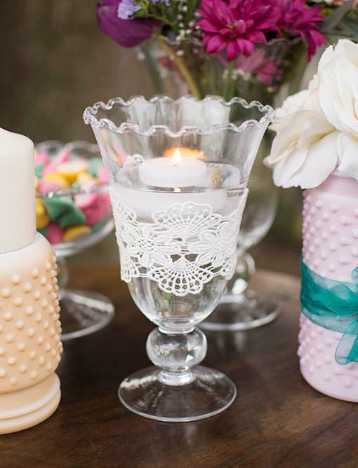 Floating candles and lace are an attractive centerpiece option, and pair beautifully with other textural glass such as our pastel hobnail, sold separately.
