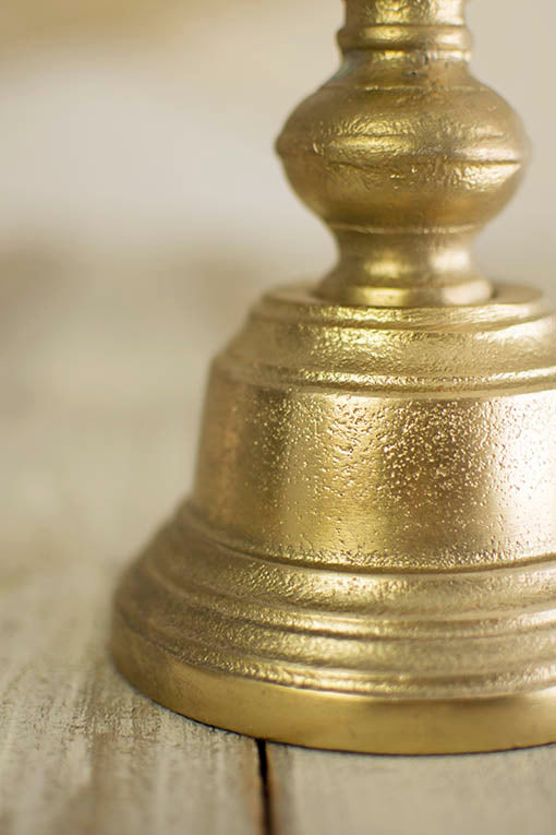 The distressed texture of our gold tone pillar candle sticks lends visual interest to your refined table top.