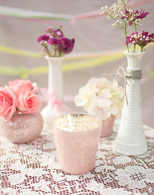 Collect the full set of our pink blush holders, pairing them with additional heirloom or hobnail pieces for tabletop texture and variety.