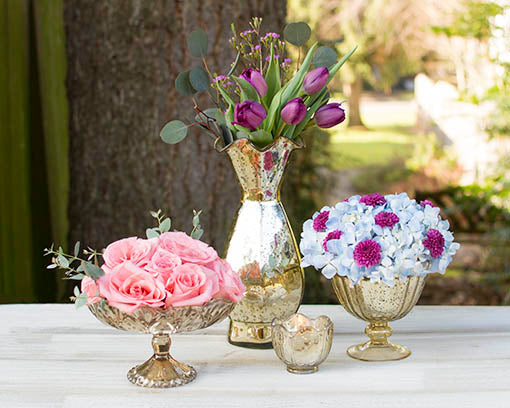 Coordinate your table tops with glamour using our full collection of gold mercury glass table decor!