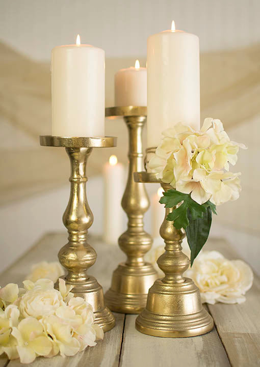Affix floral cascades to these tasteful candle holders to make a big impact. Mix and match different sizes of these candlesticks, as well as different sizes of pillar candles, for a beautiful staging.