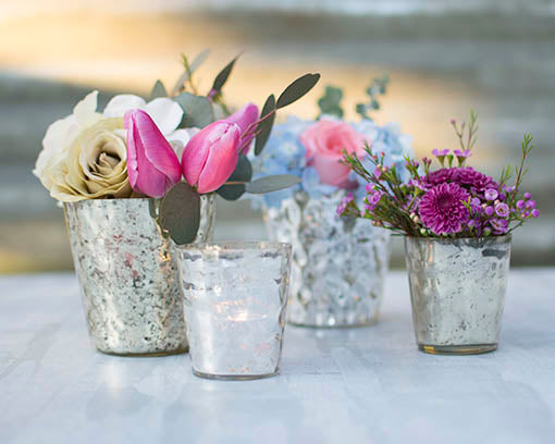 Design your tablescape with a variety of candles and flowers, mixing and matching mercury glass candle holders.