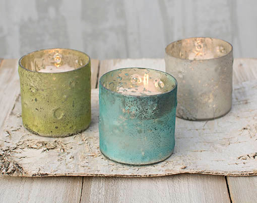 'Contemporary rustic' perfectly describes these matte finished votive candle holders. Choose a single color or mix it up for variety!