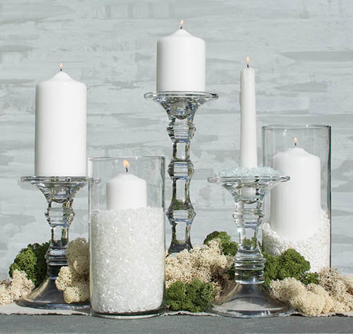 Natural and green mosses displayed here with a variety of clear glass table decor, glass vase filler and event candles, each sold separately.