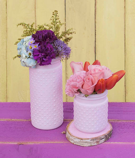 Use one color scheme or mix it up for a memorable vintage chic look. Different sizes of our pastel pink hobnail vases are sold separately.