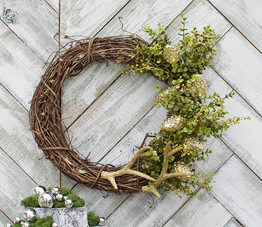 Create your own woodland wreath by adding these pine cone lights to a grapevine wreath with a eucalyptus spray and antler floral pick.