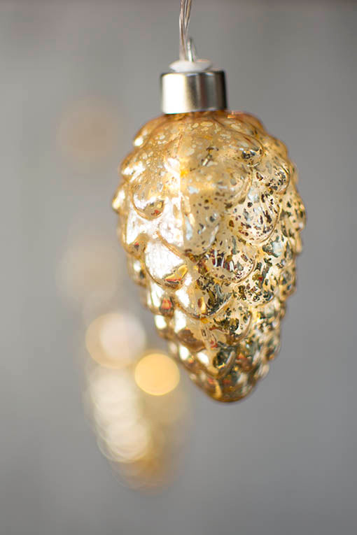With a gold mercury glass finish, string this strand in holiday decor or industrial style designs.