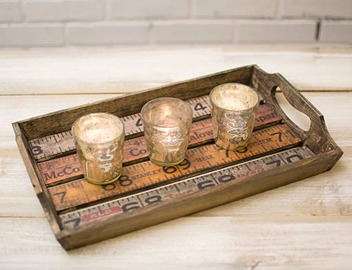 Pair our wood ruler serving trays with mercury glass candle shelters for a simply rustic centerpiece.