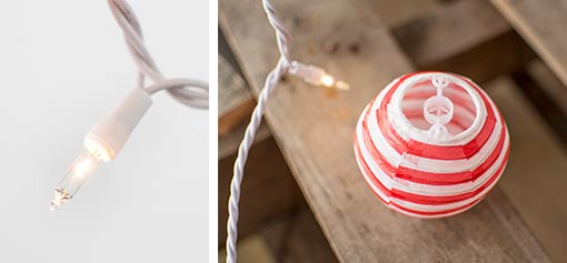 Our patriotic paper lantern string light set includes ten 2.75 inch round paper lanterns, each lit by warm white incandescent bulbs.