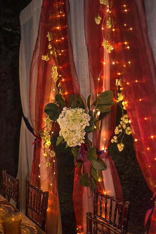 Brighten romantic fairytale scenes in your wedding or special event by pairing these fairy lights with organza.