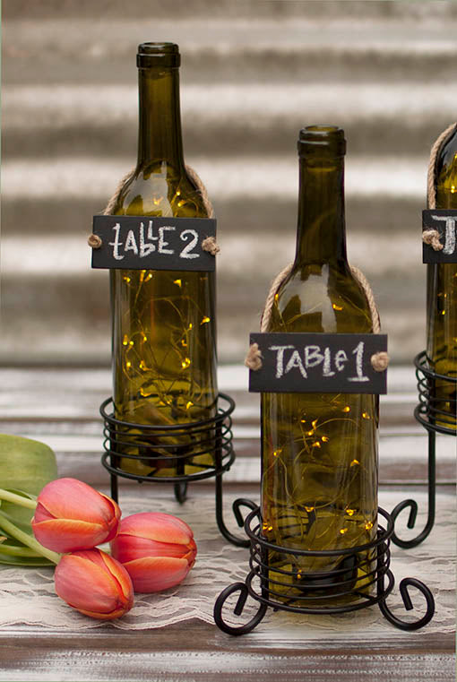 Green Wine Bottle Candle Holder shown with warm white fairy lights and bottle necklace signs