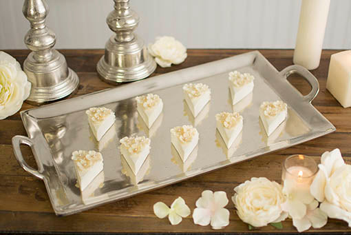 Our tasteful silver serving tray is simply perfect for elegant events and centerpieces. To get this look, pair with scattered flowers and flower petals, our silver pillar candle holders and a variety of pillar candles.