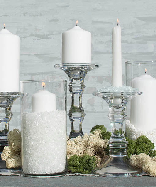 Go for clean and classic with clear glass candle accessories, naturally complemented by our event candles, vase fillers and real mosses.