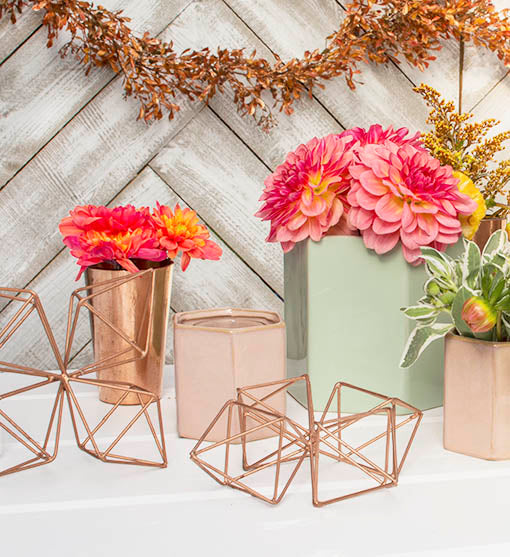 Set a modern table with our copper decorations and ceramic hexagonal planters.