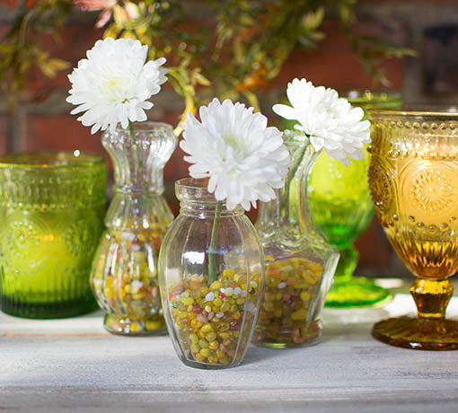 Add our fine filler to small bud vases and pair with colored glass in like colors. All items sold separately.