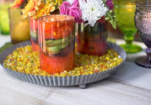 Dress a tray to the nines using our filler to add vibrant color to a collection of votive candle holders or pillar candles!