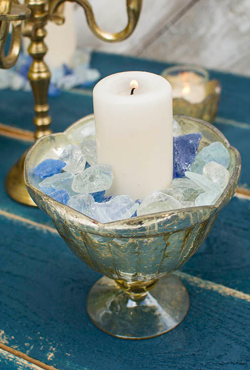 Surround real or flameless wax pillar candles with our colorful sea glass! Pictured with gold mercury glass and metallic accessories, sold separately.
