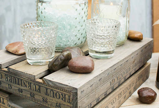 For color and visual texture, add river rocks to candle arrangements and centerpieces. Candles, candle accessories and crates sold separately.