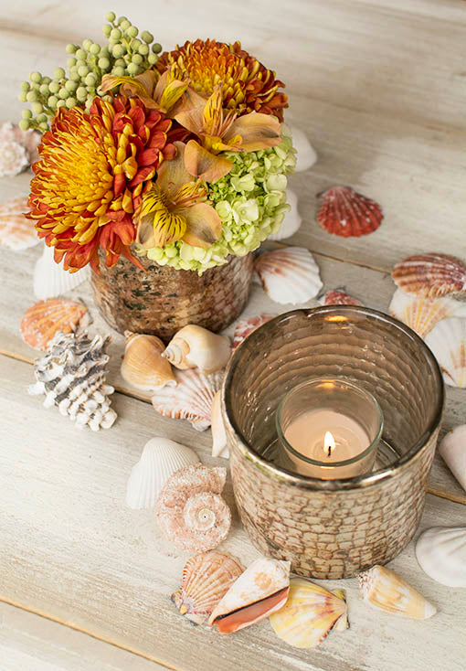 Scatter the shells around mercury glass vases filled with candles and floral arrangements for a sea worthy centerpiece.